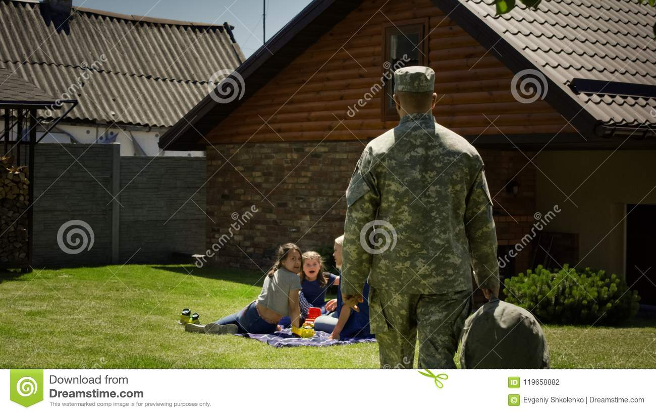 Military man returning home to family