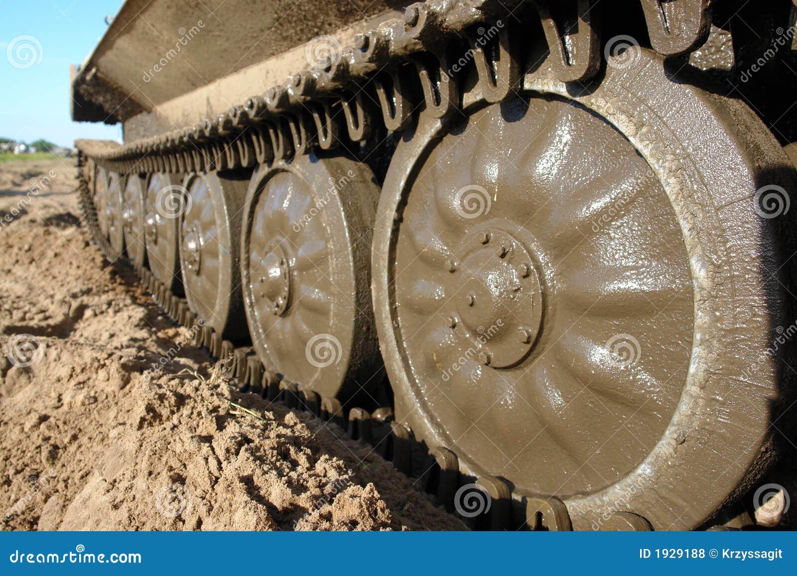 Military tank caterpillar, mudded.