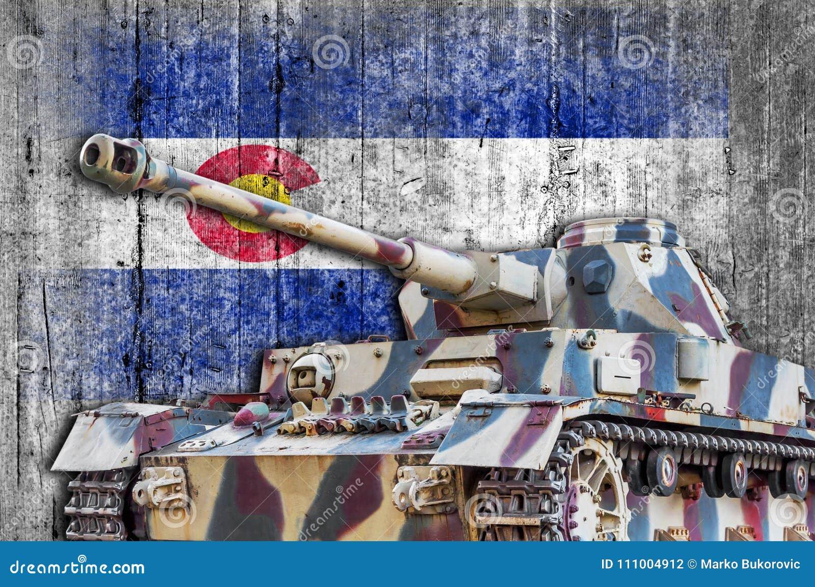 Military tank with concrete Colorado flag