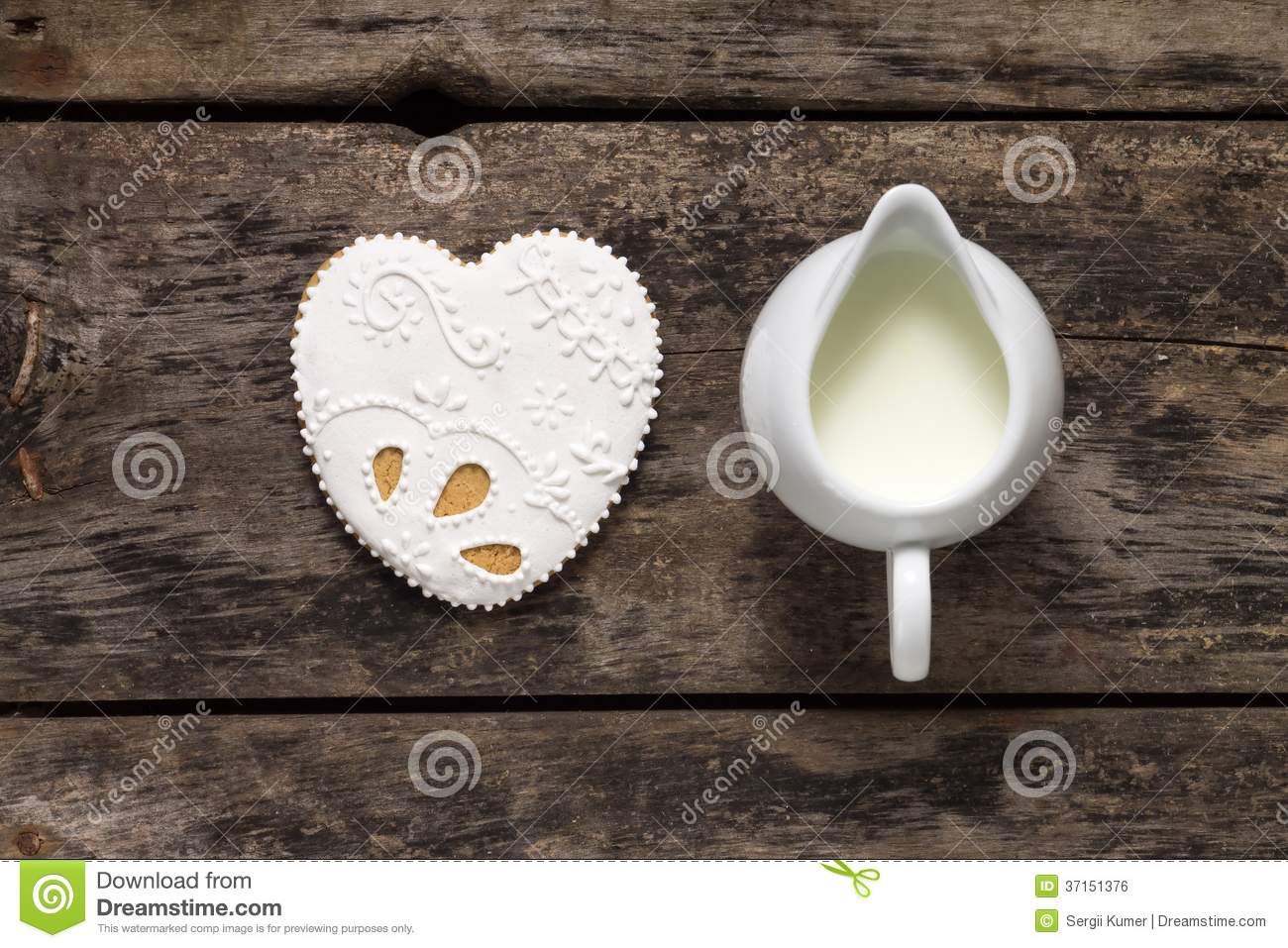 Milk with big Gingerbread Cookies on old wood background