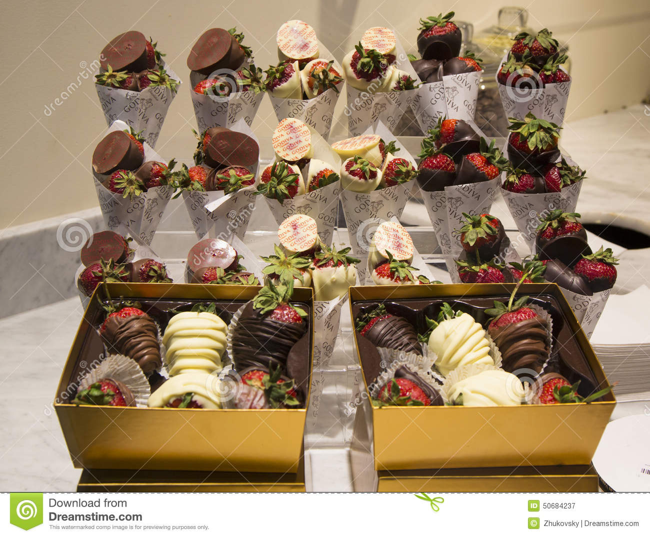 Milk And Dark Chocolate Dipped Strawberries By Godiva Editorial ...