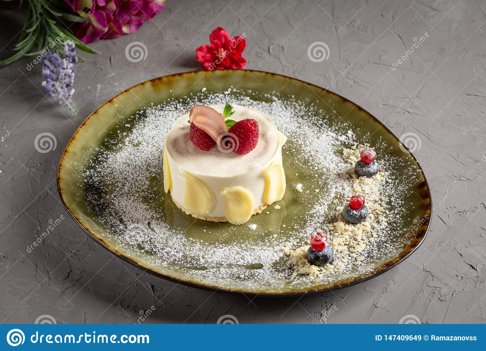 Milk dessert with fruit and chocolate on a gray background