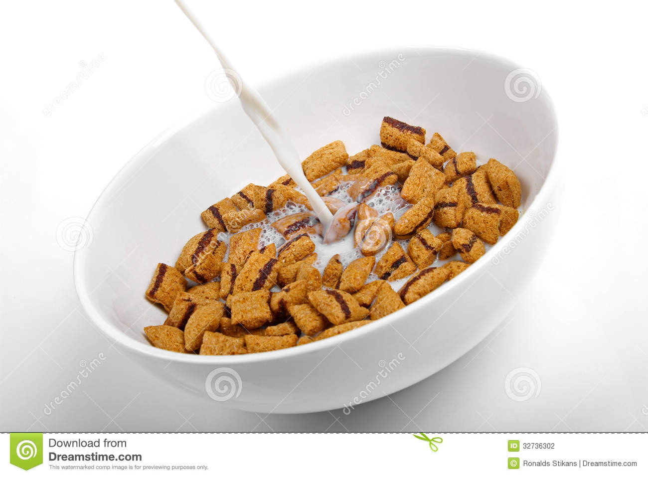 Bowl Of Cornflakes And Milk Milk Pouring Into A Bo...