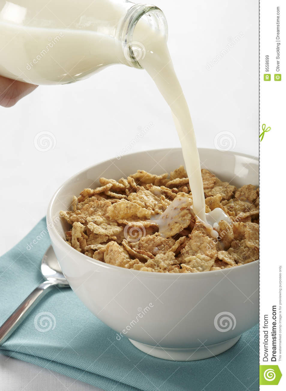 ... view of milk being poured from a bottle into a bowl of cereal flakes