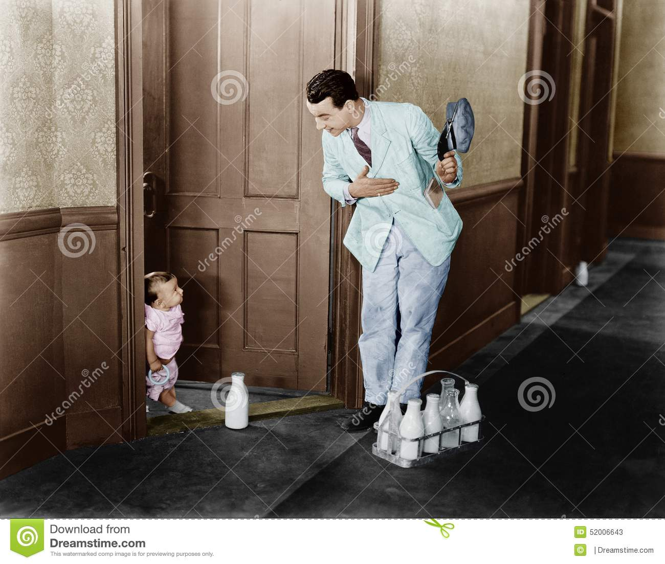 Milkman greeting baby at door