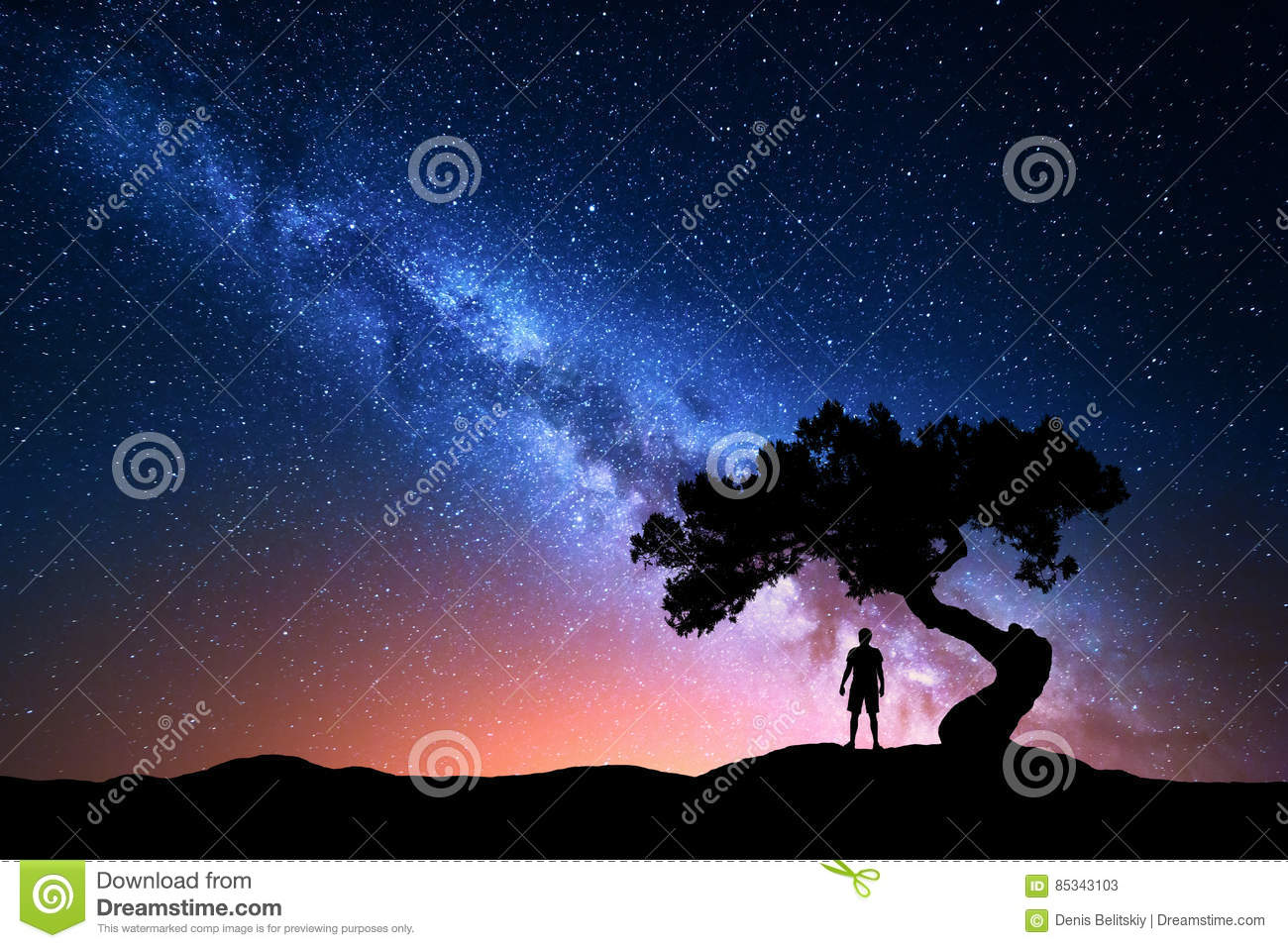 Milky Way, tree and silhouette of alone man. Night landscape