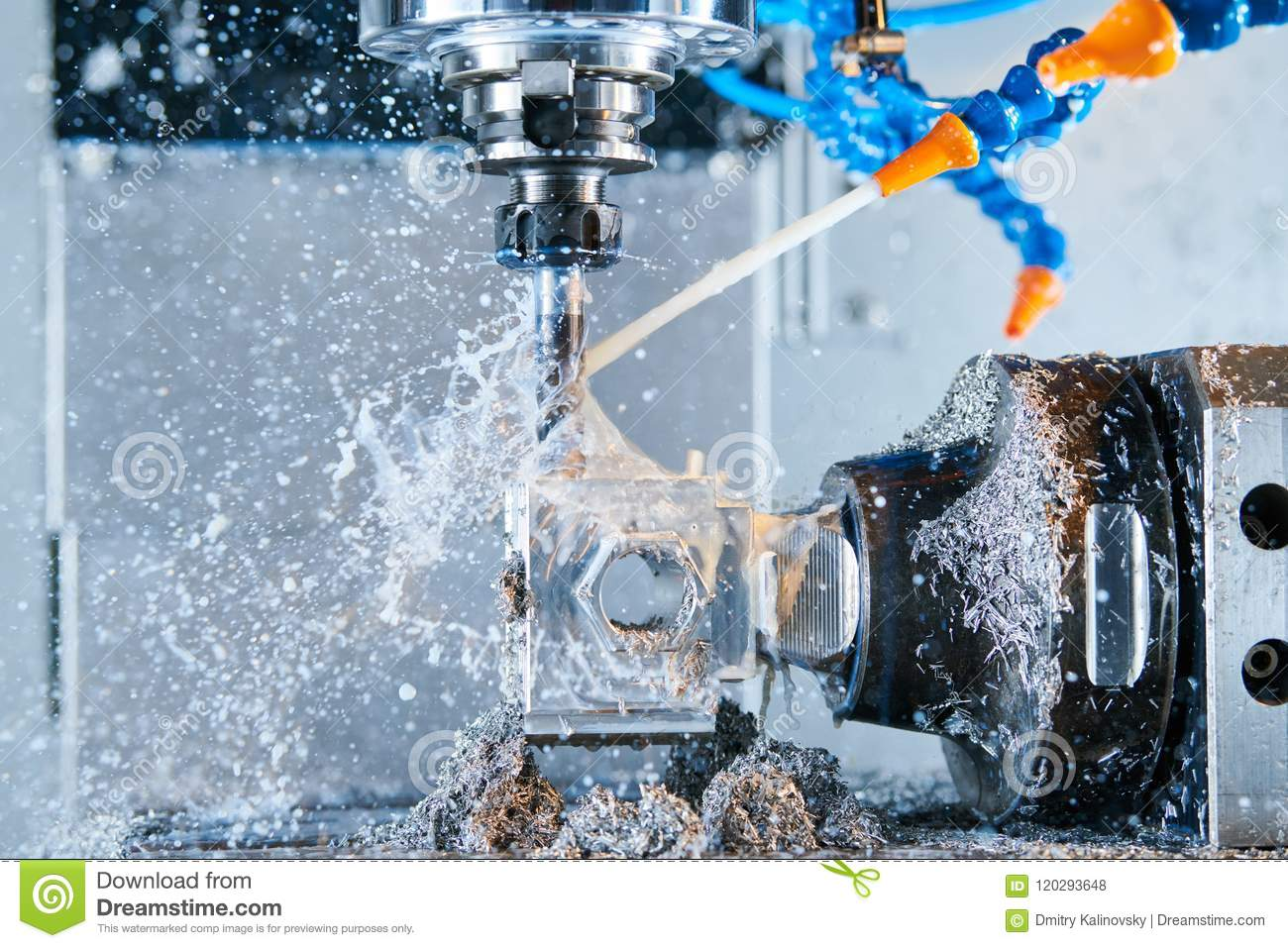 Milling metalworking. CNC metal machining by vertical mill. Coolant and lubrication