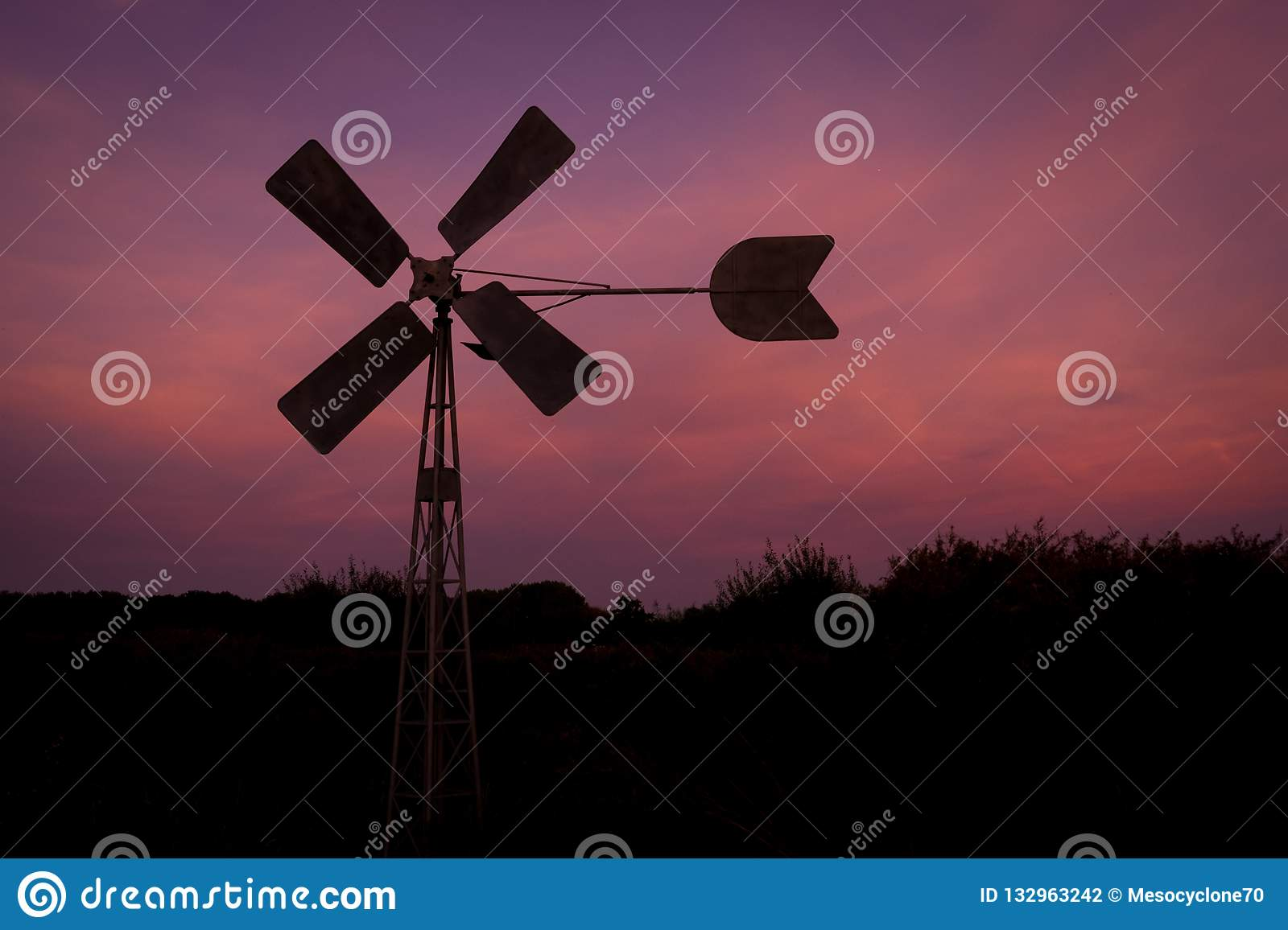 Silhouette of a windmill against a purple evening sky near Gouda, Holland