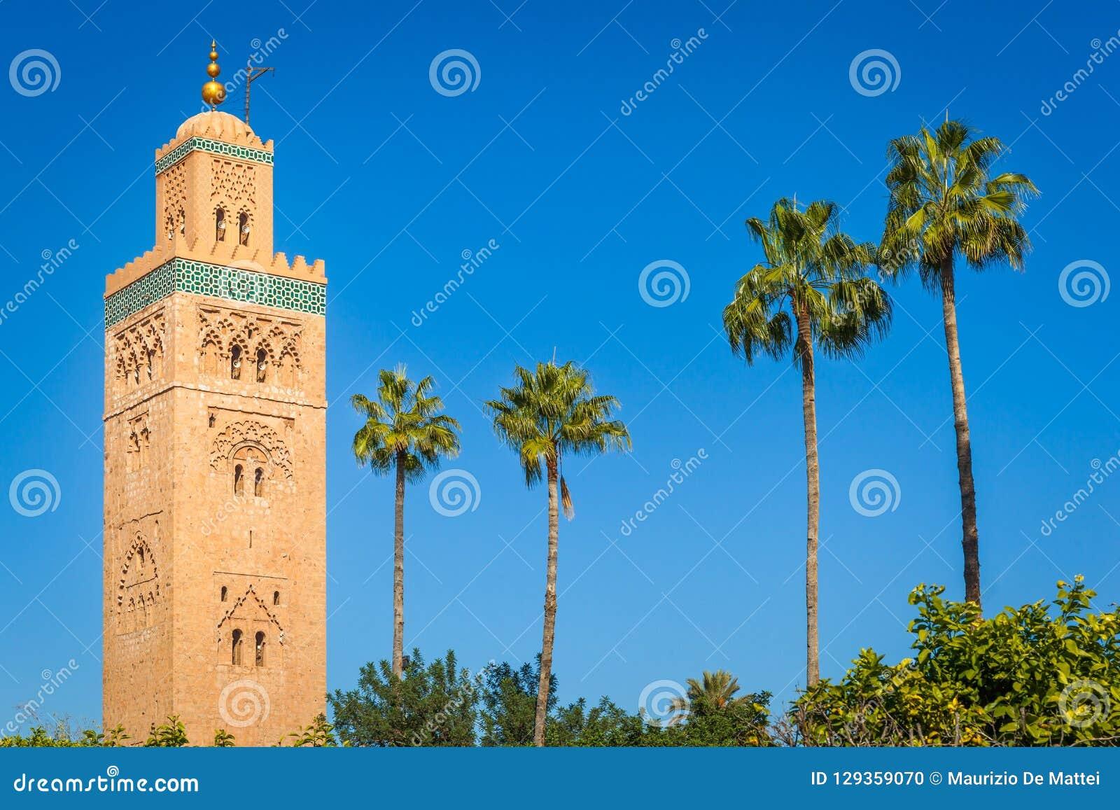 Historic minaret and palm trees