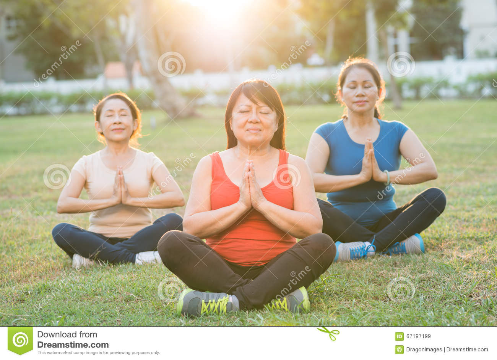Asian mature women meditating in lotus position