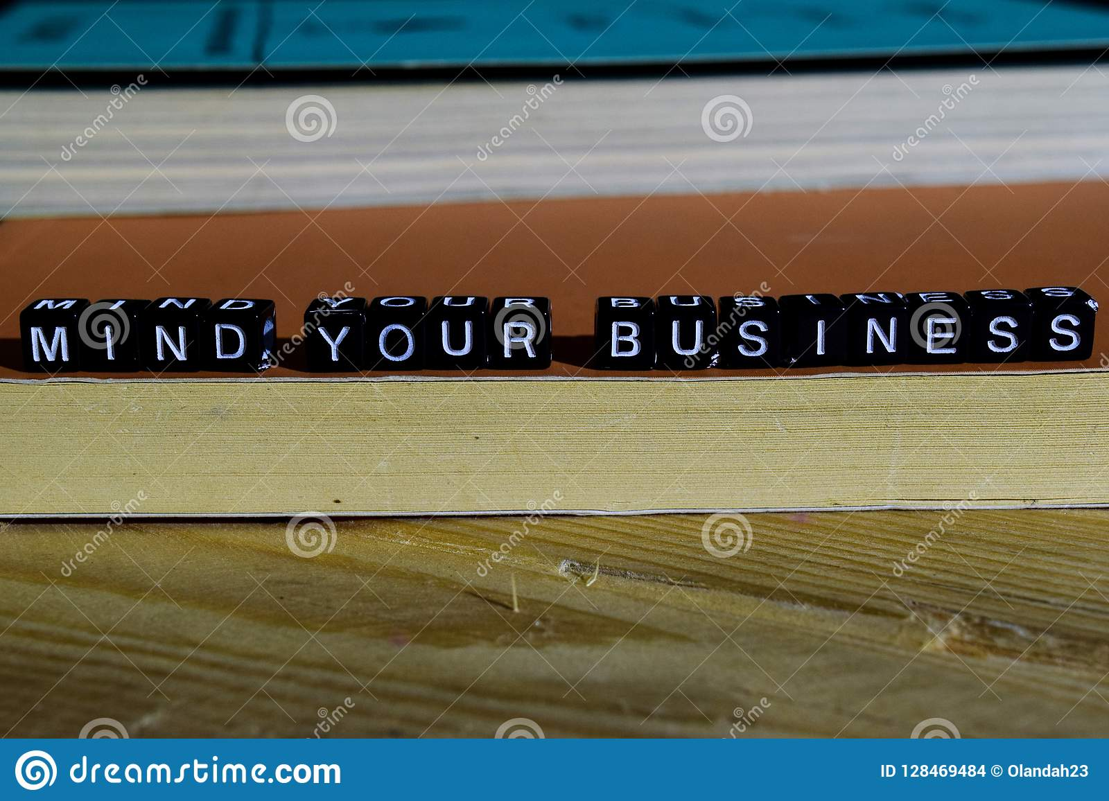 Mind your business on wooden blocks. Motivation and inspiration concept