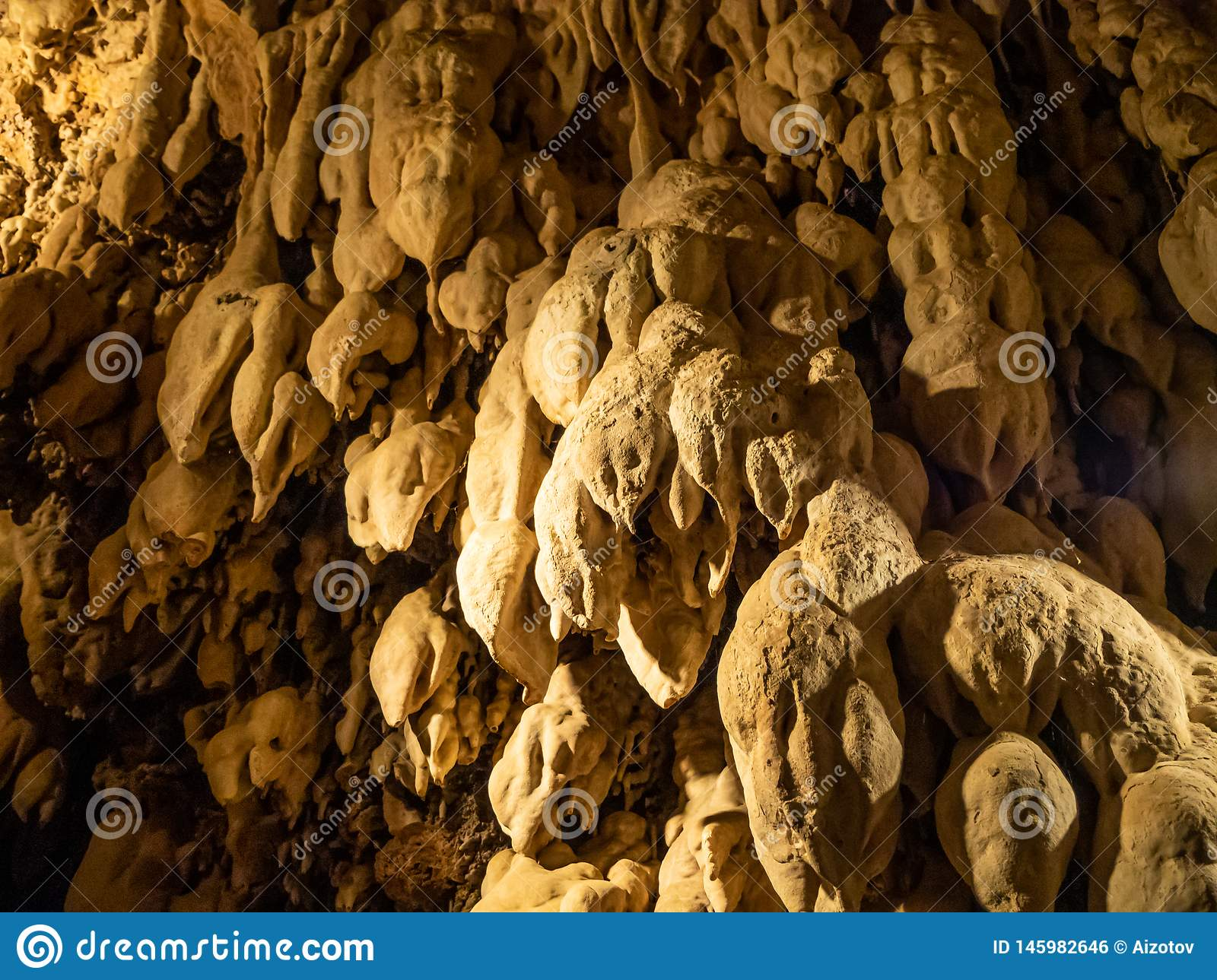 Mineral growths stalactites and stalagmites in a cave in the waterfalls park in the city of Edessa, Greece
