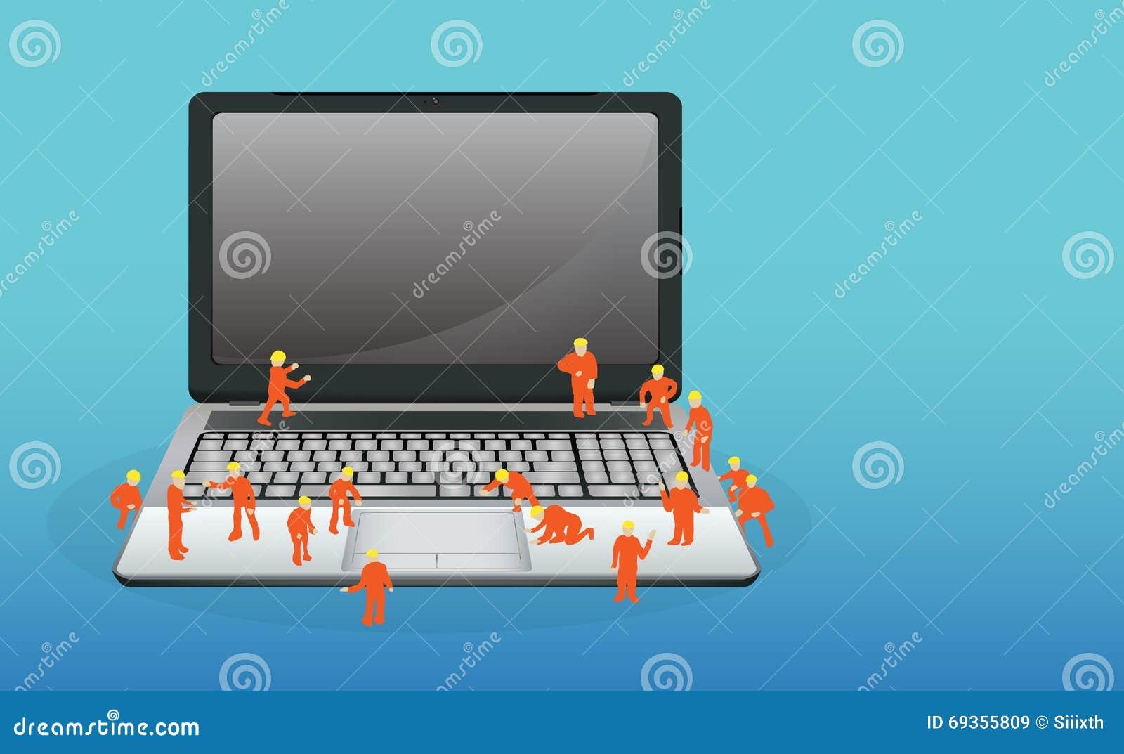 Mini- arbetare som arbetar på en bärbar datordator