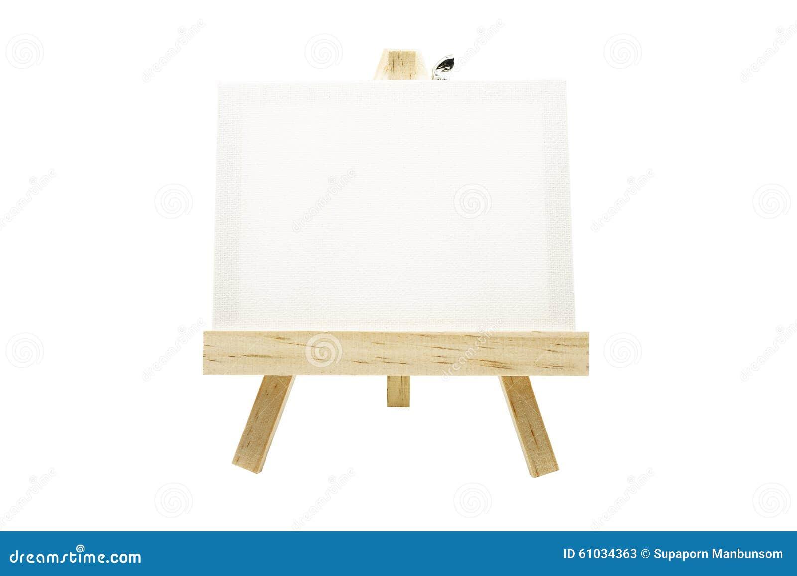 Mini caballete de madera con el marco en blanco de la lona aislado