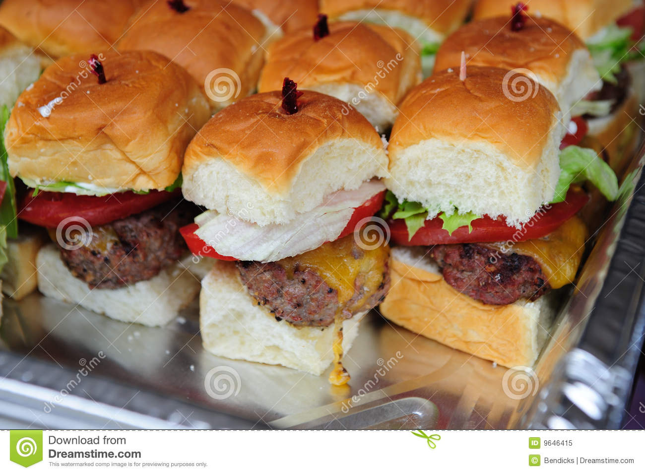 Little hamburgers with lettuce, tomato and cheese ready to serve.