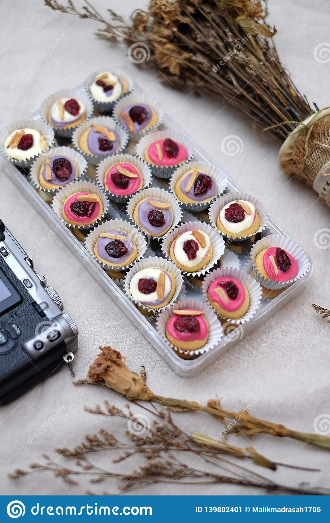 Mini Donuts com câmera e a folha seca