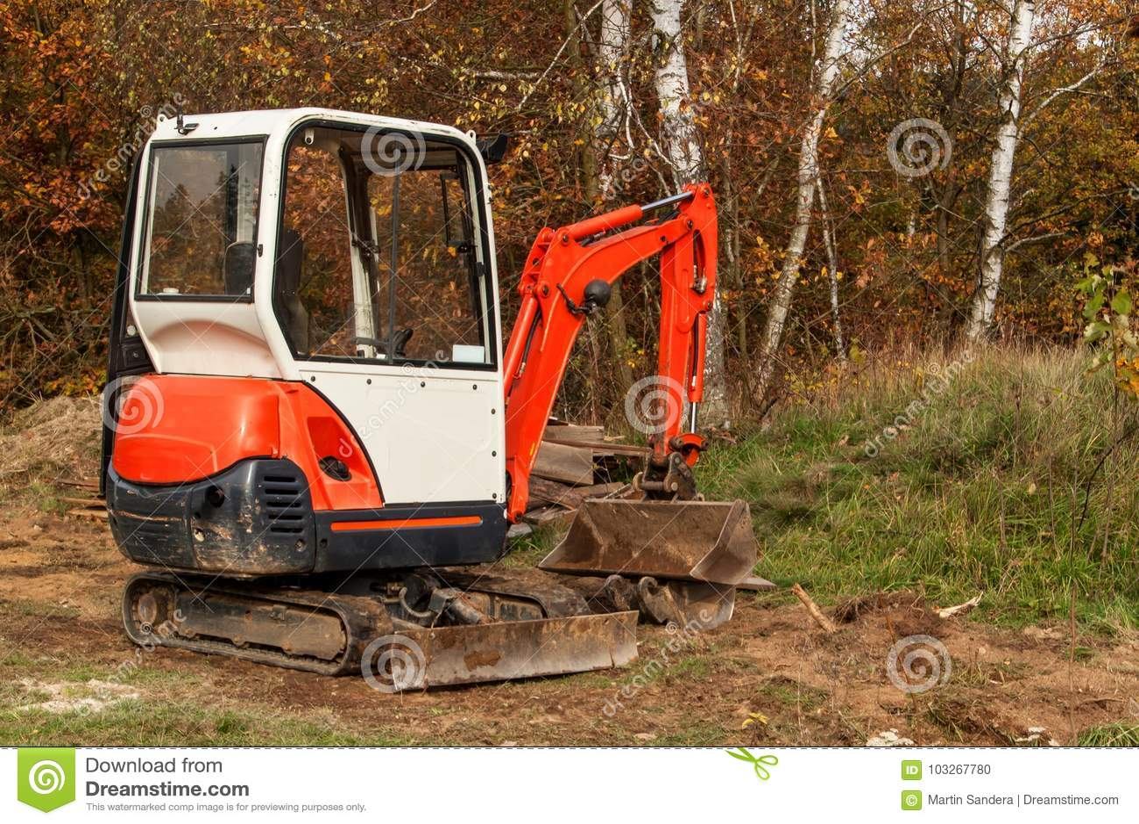 Mini Excavator On A Building Site. Excavation Work. The Excavator ...