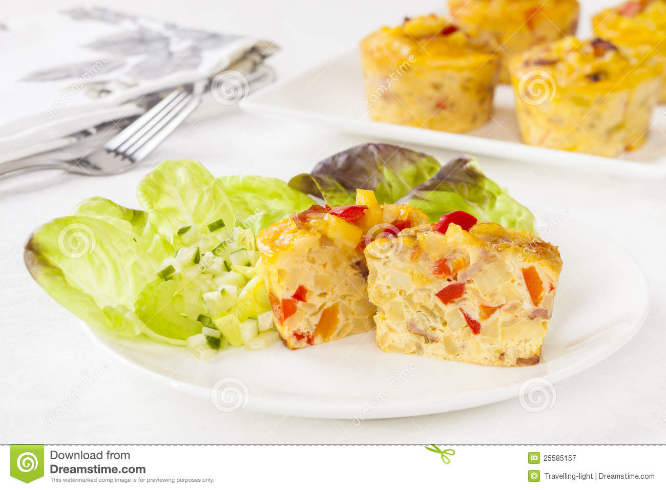Mini frittata on a plate with salad.