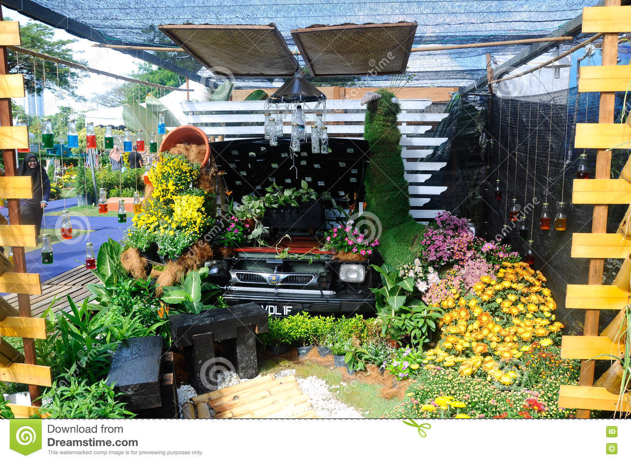 Mini garden built using recycled materials editorial photo for Garden made of waste material