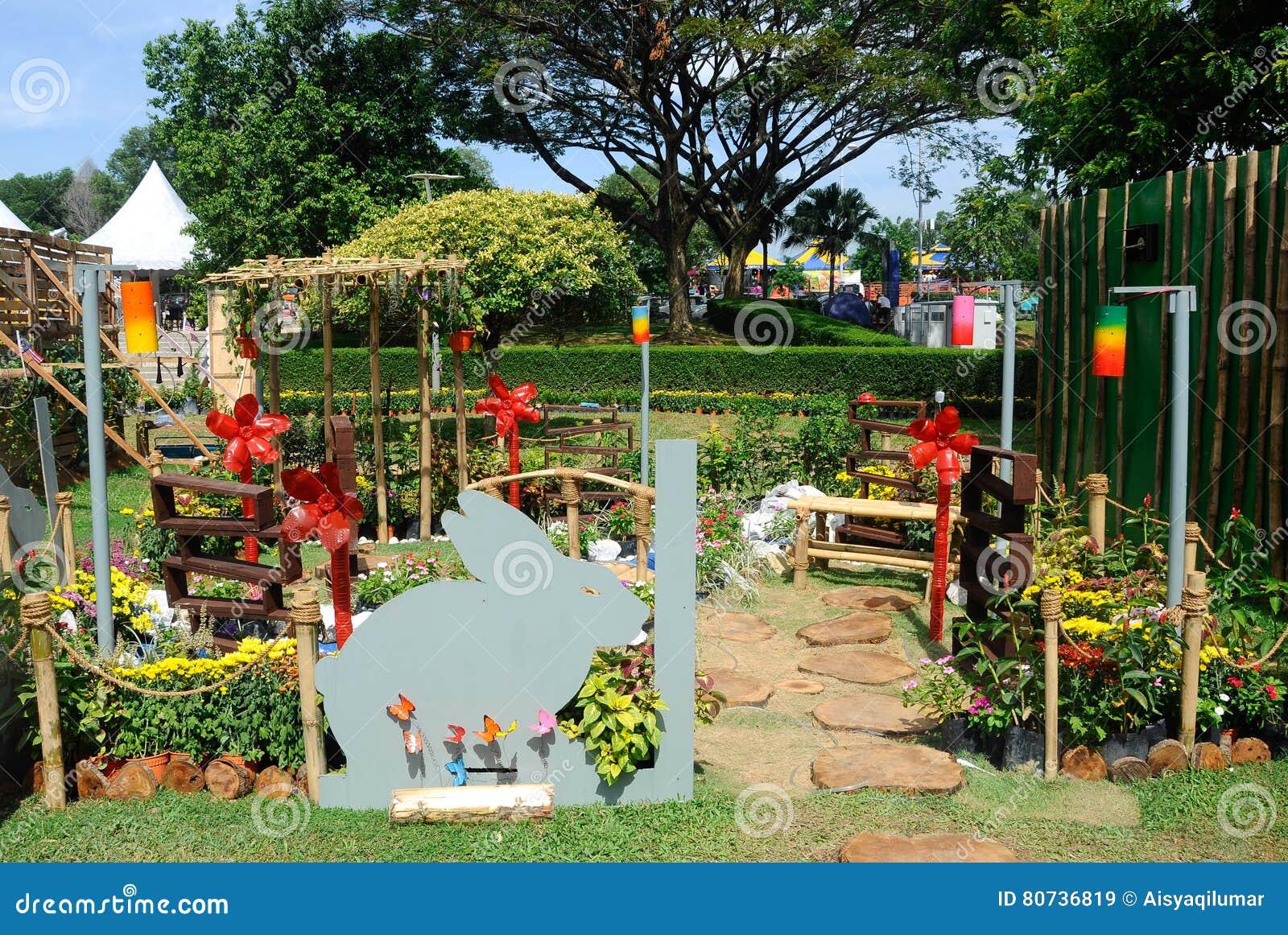 Mini garden built using recycled materials editorial stock for Using recycled materials in the garden