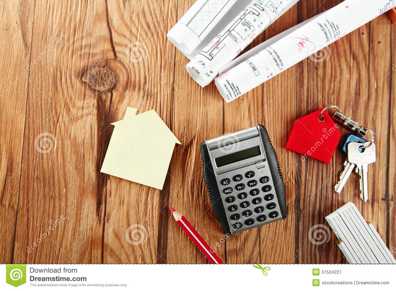 Mini house sketch keys and calculator on table stock for Build new house calculator