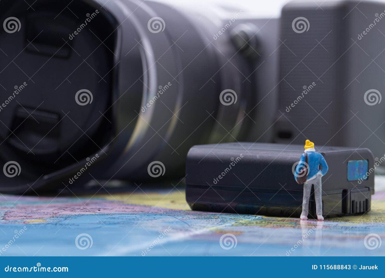 Mini people model checking digital camera for travel
