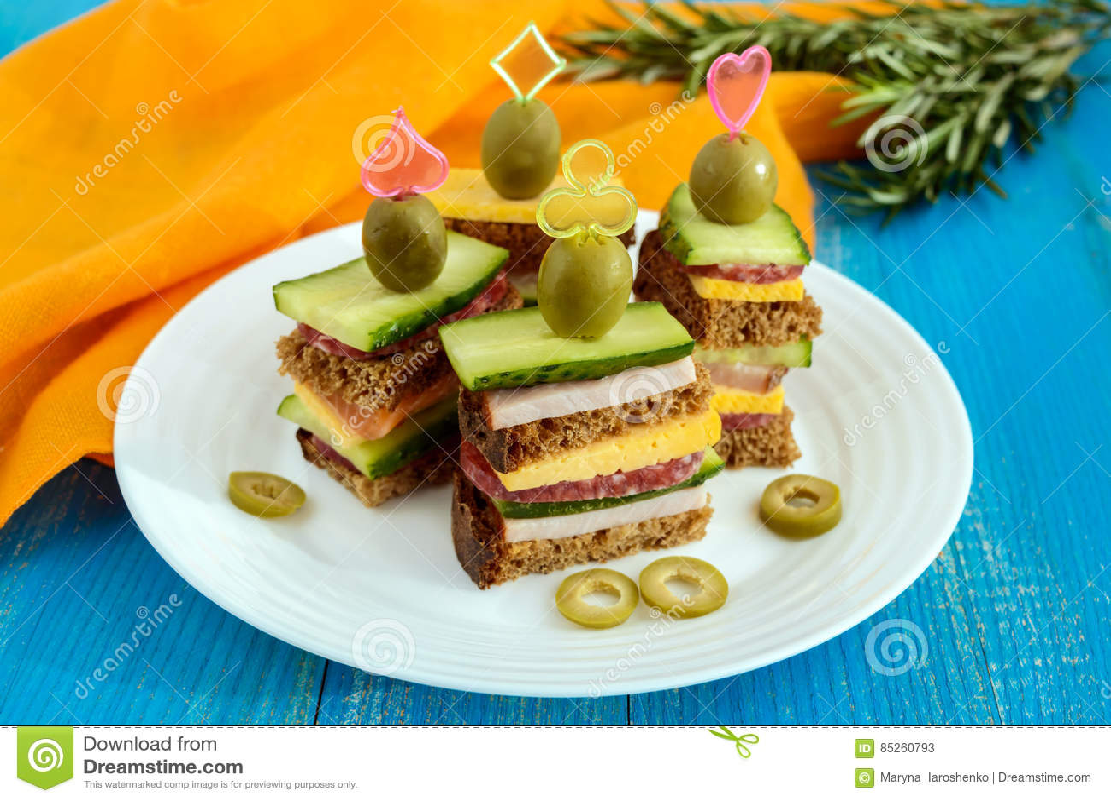 mini sandwiches canape with fresh cucumbers ham cheese olives salami black - Mini Canape