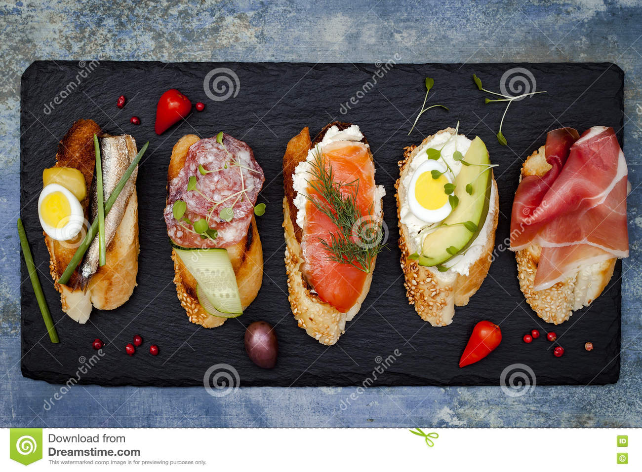 Mini sandwiches food set. Brushetta or authentic traditional spanish tapas for lunch table. Delicious snack, appetizer, antipasti