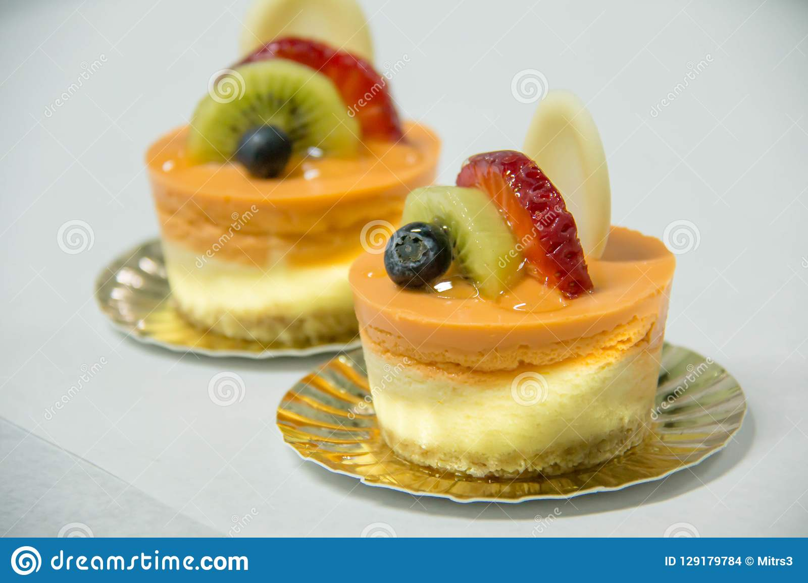 Mini Thai Tea Cheese Cake With Fruit On Top Stock Photo