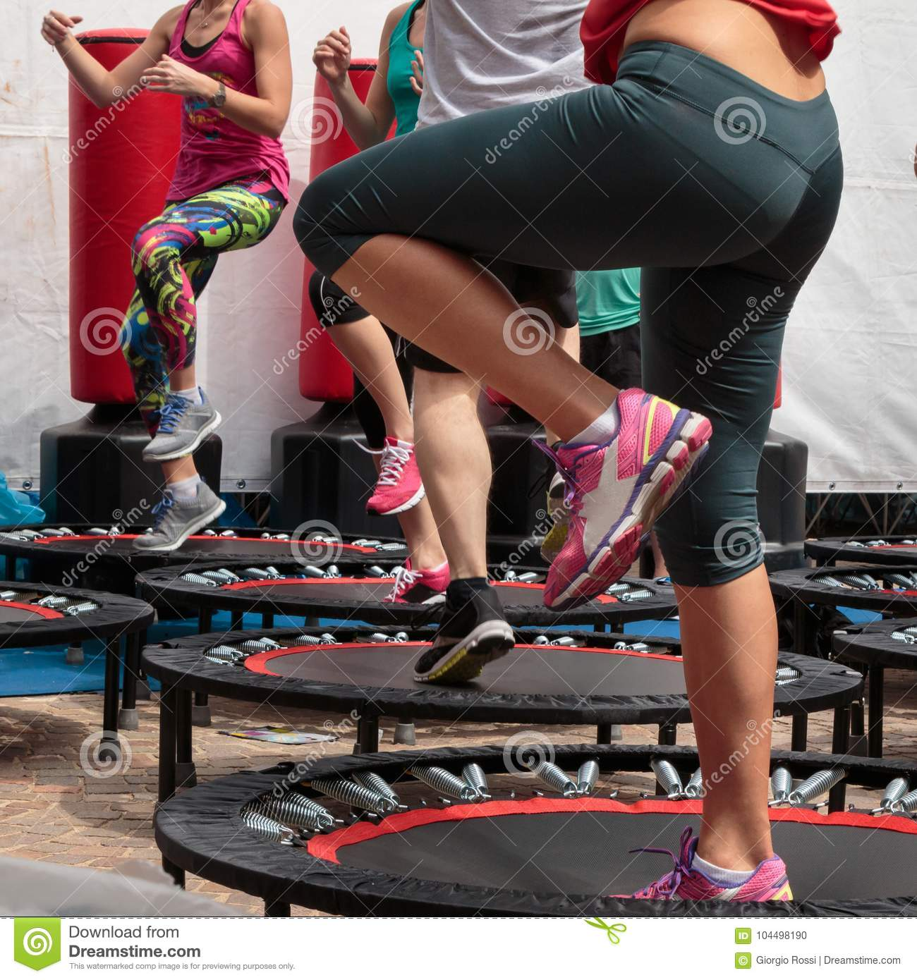 b9812388926f2 Mini Trampoline Workout  Girl Doing Fitness Exercise In Class At Gym ...
