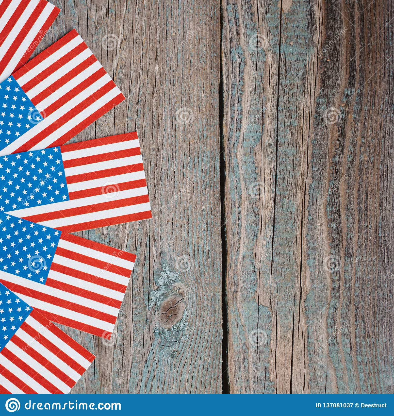 Miniature American Flags On Brown Wooden Table Stock Image