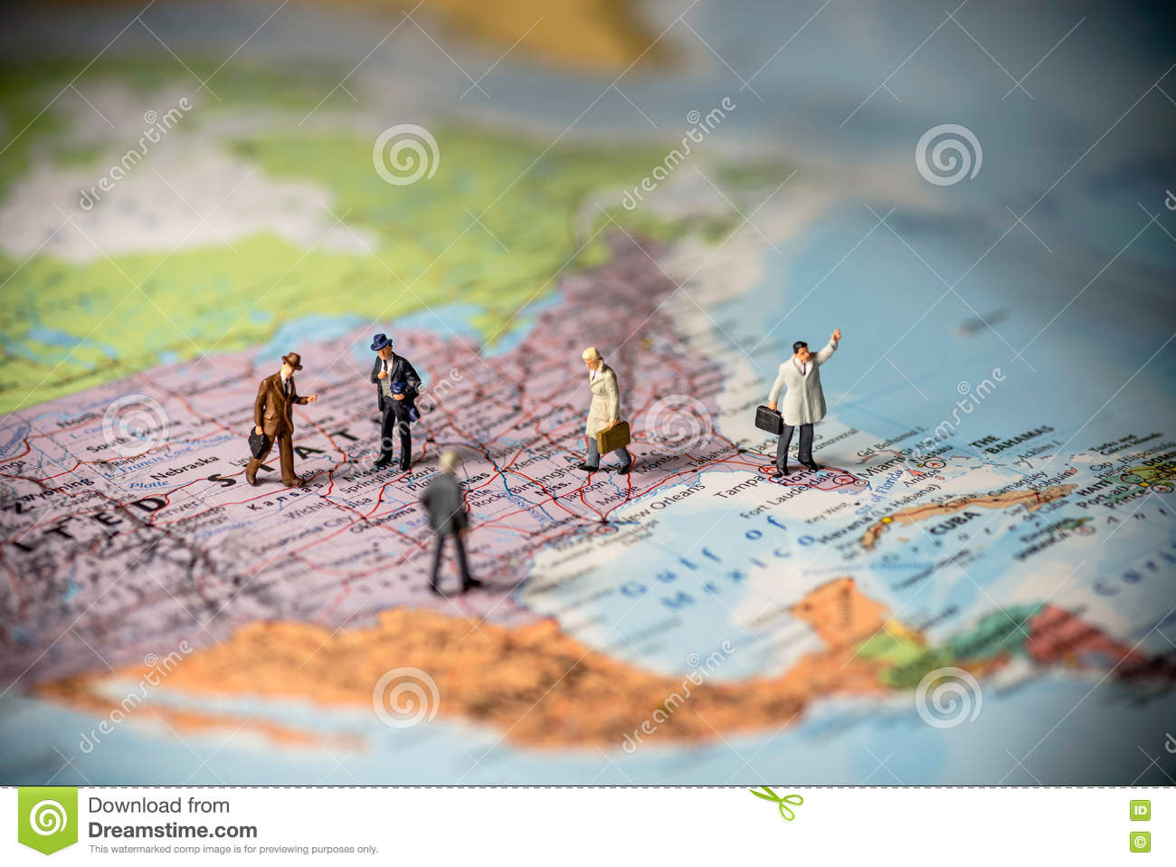 Miniature Business People On Top Of US Map Business Concept Co - Us map business