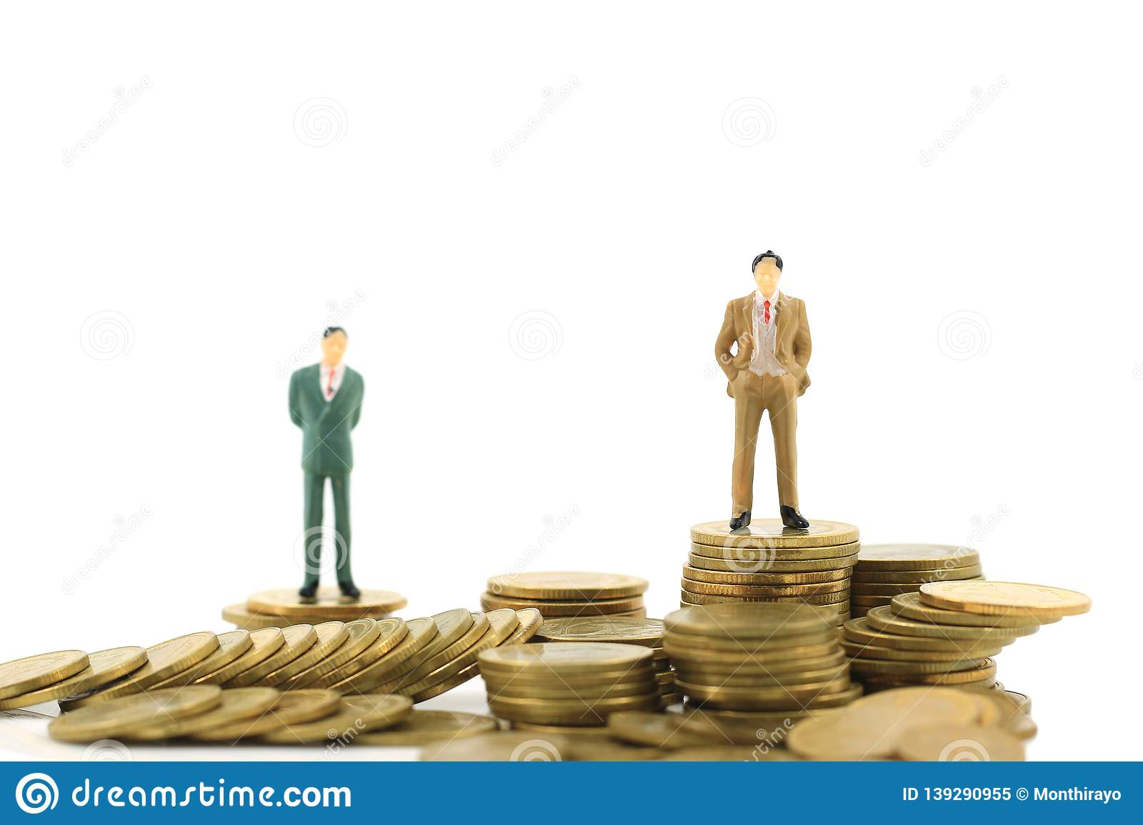 Miniature businessman standing on stack of coins money on white background, investment and business financial concept
