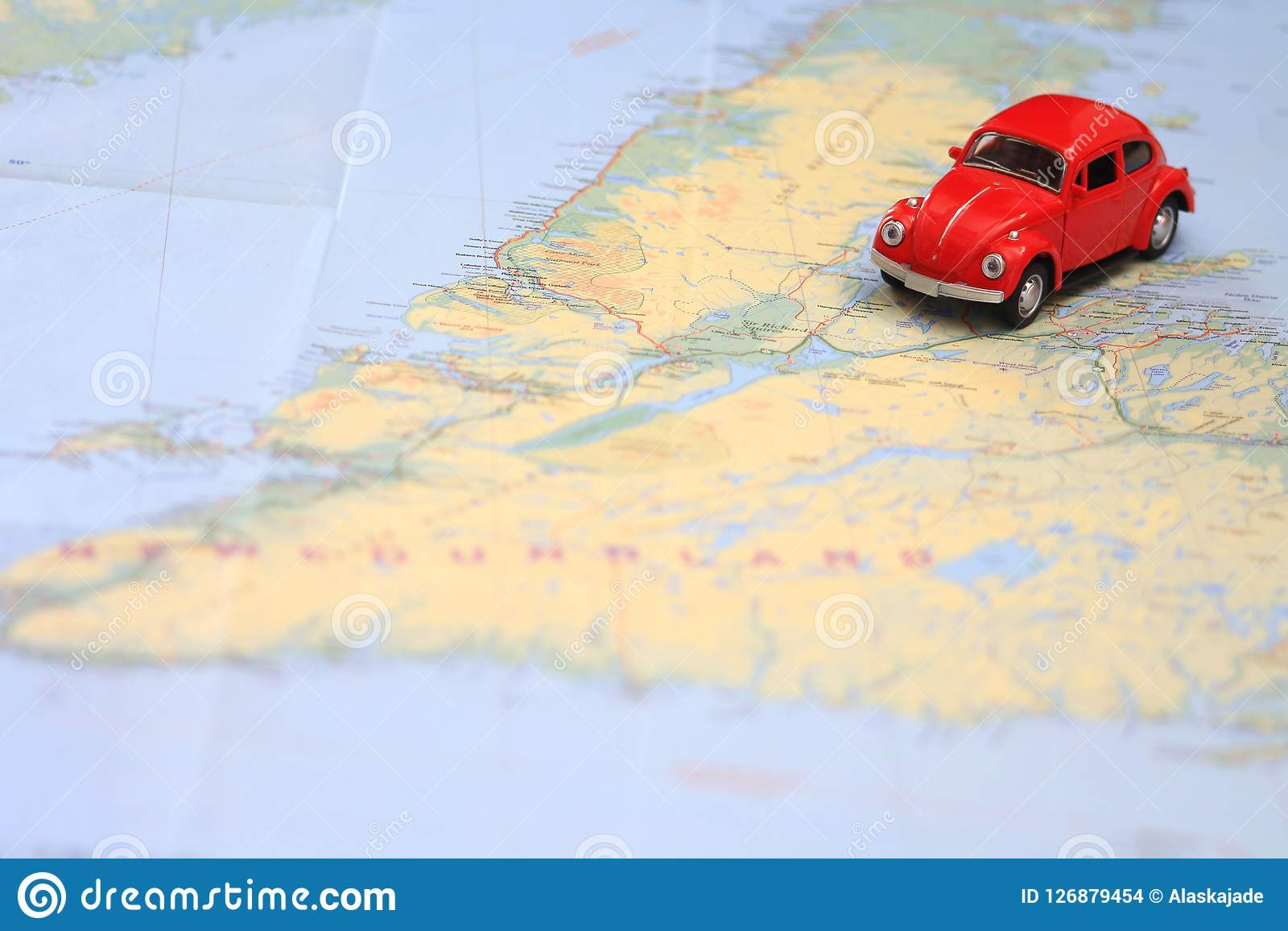 Map Of Canada Driving.Miniature Car Driving On A Map Of Newfoundland Canada Stock