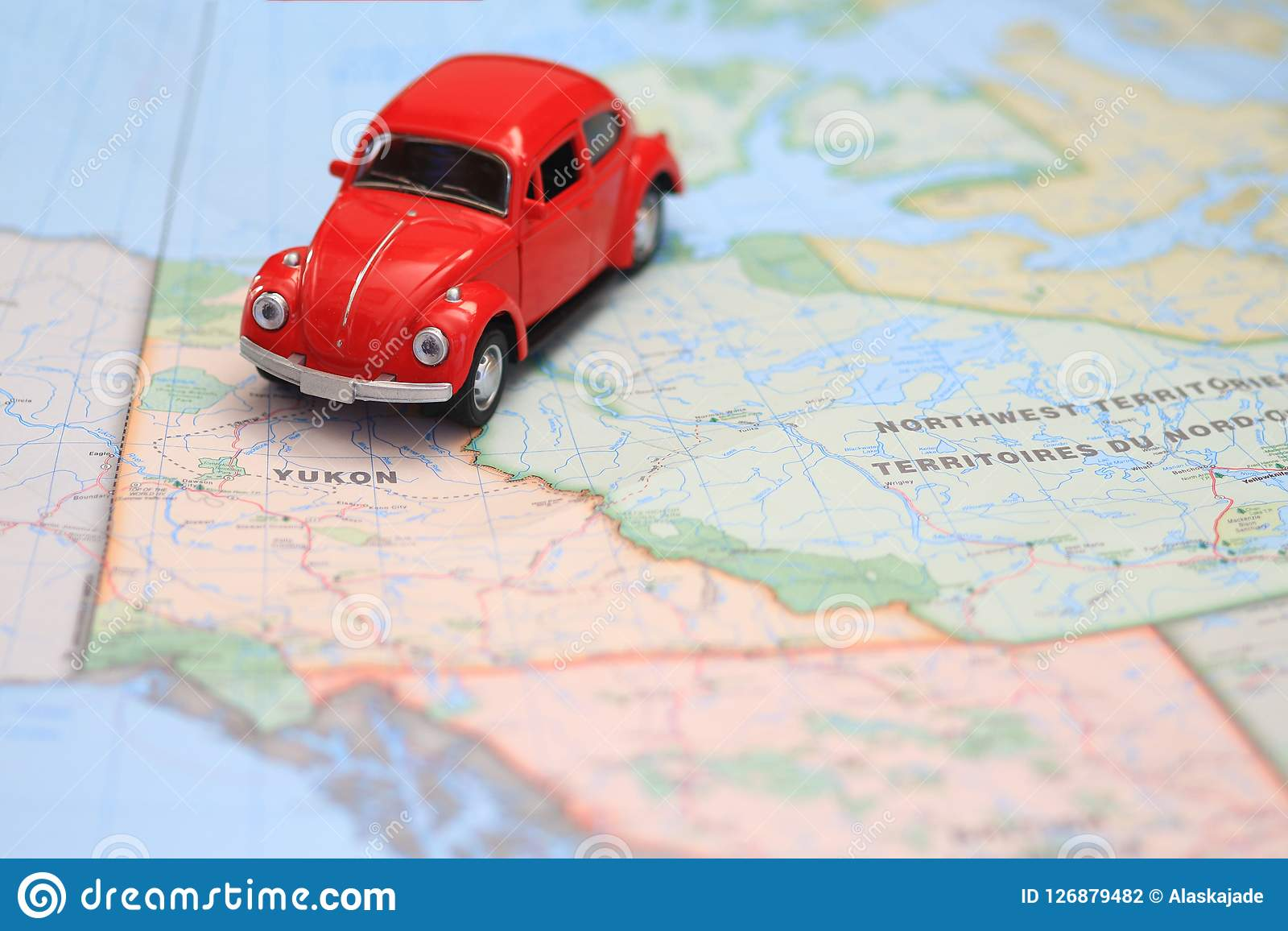 Canada Map Driving Miniature Car Driving On A Map Of The Yukon Canada Stock Photo