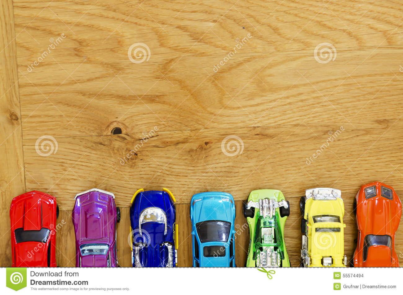 Miniature Cars Lined Up On A Wooden Floor Stock Photo