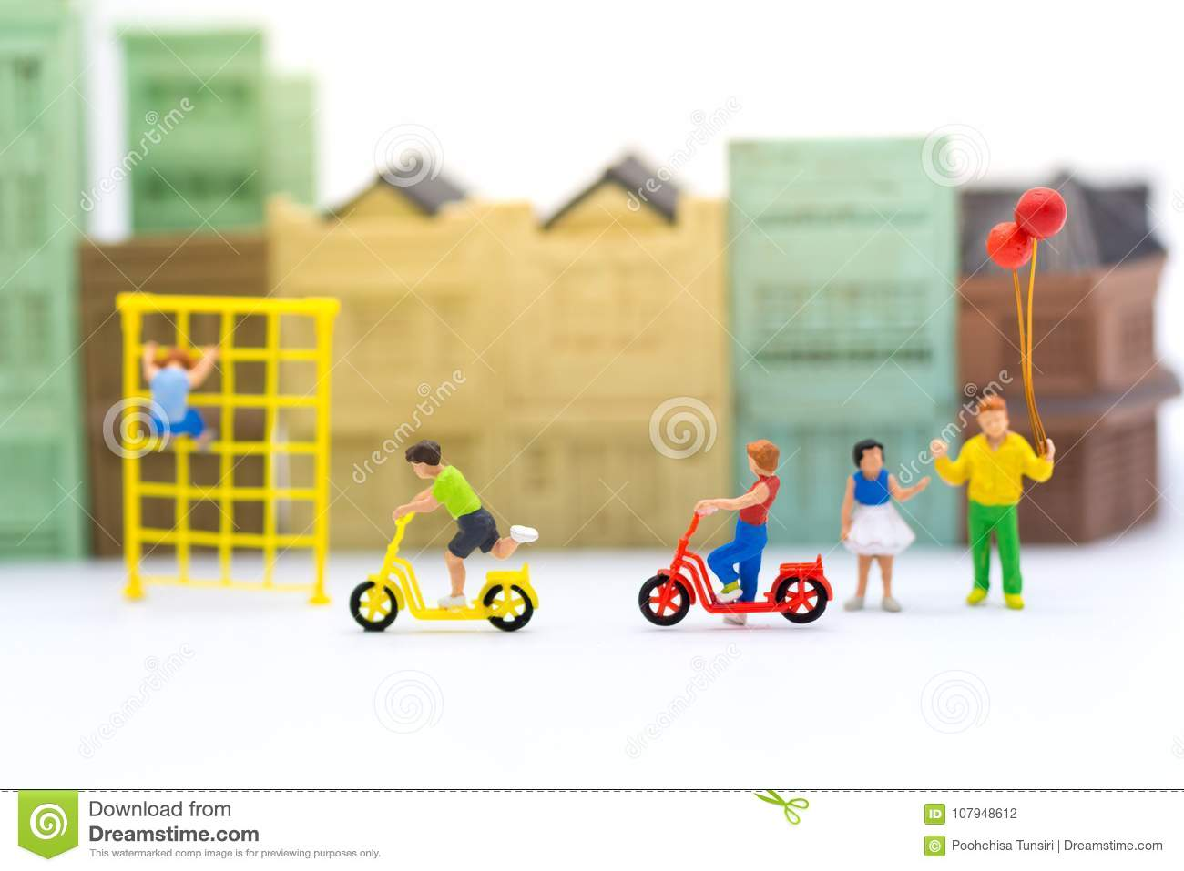 Miniature children: Boys cycling play fun in the playground. Image use for Children`s day