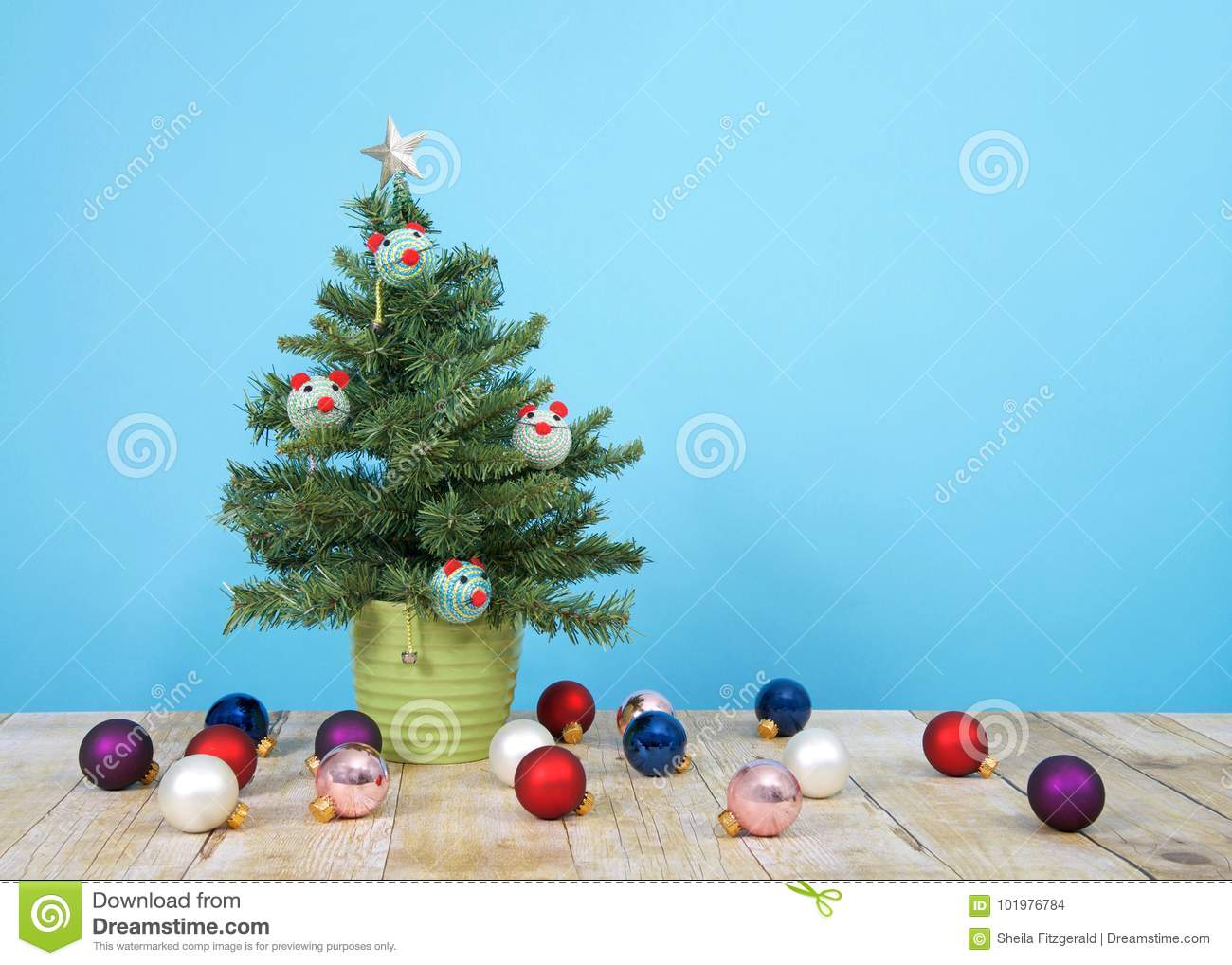 miniature christmas tree with cat toys and fallen ornaments - Miniature Christmas Tree Ornaments