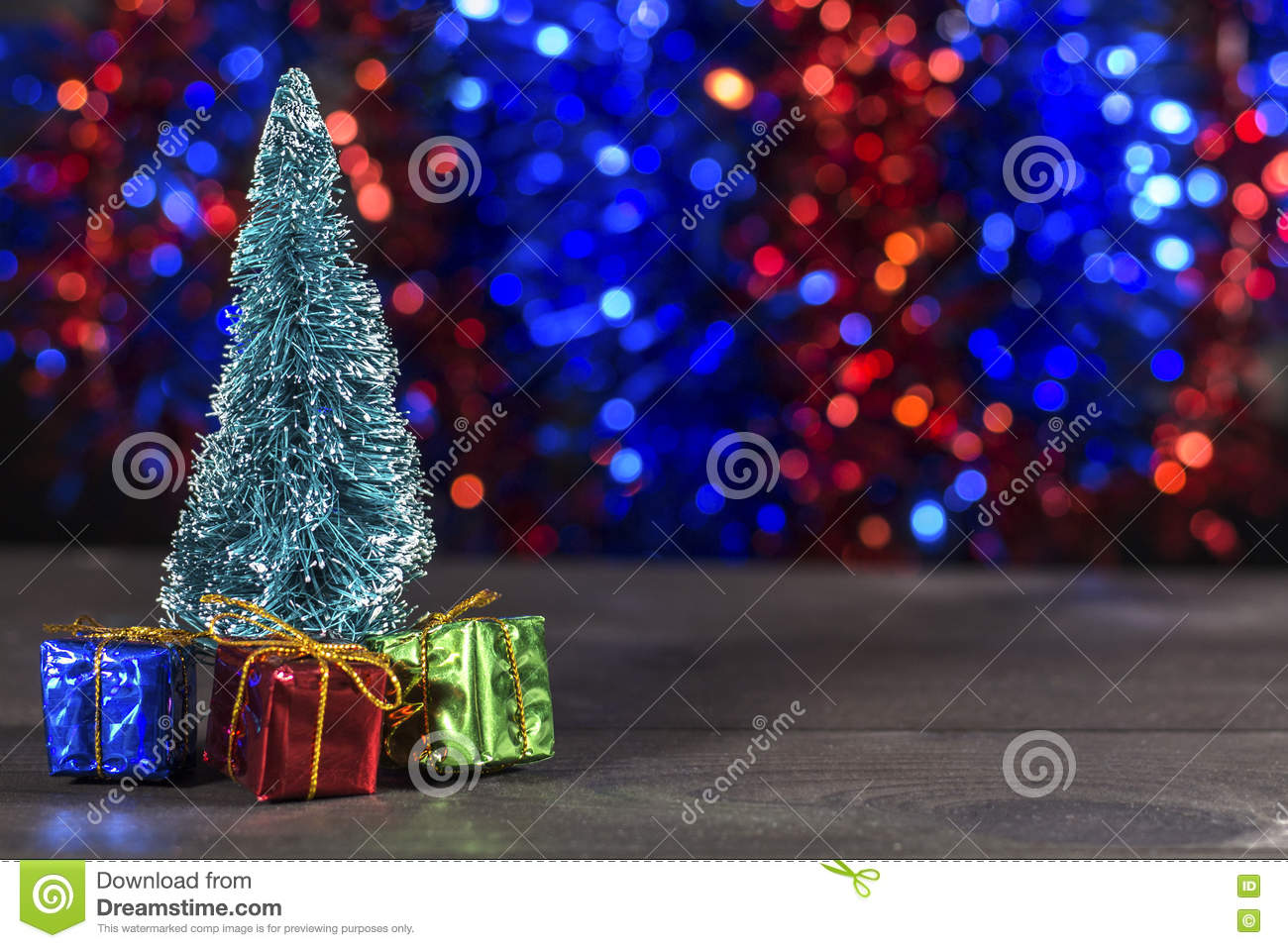 Miniature Christmas Tree With Mini Christmas Gifts On Two Color Bokeh Background Stock Photo Image Of Gift Color 79241290