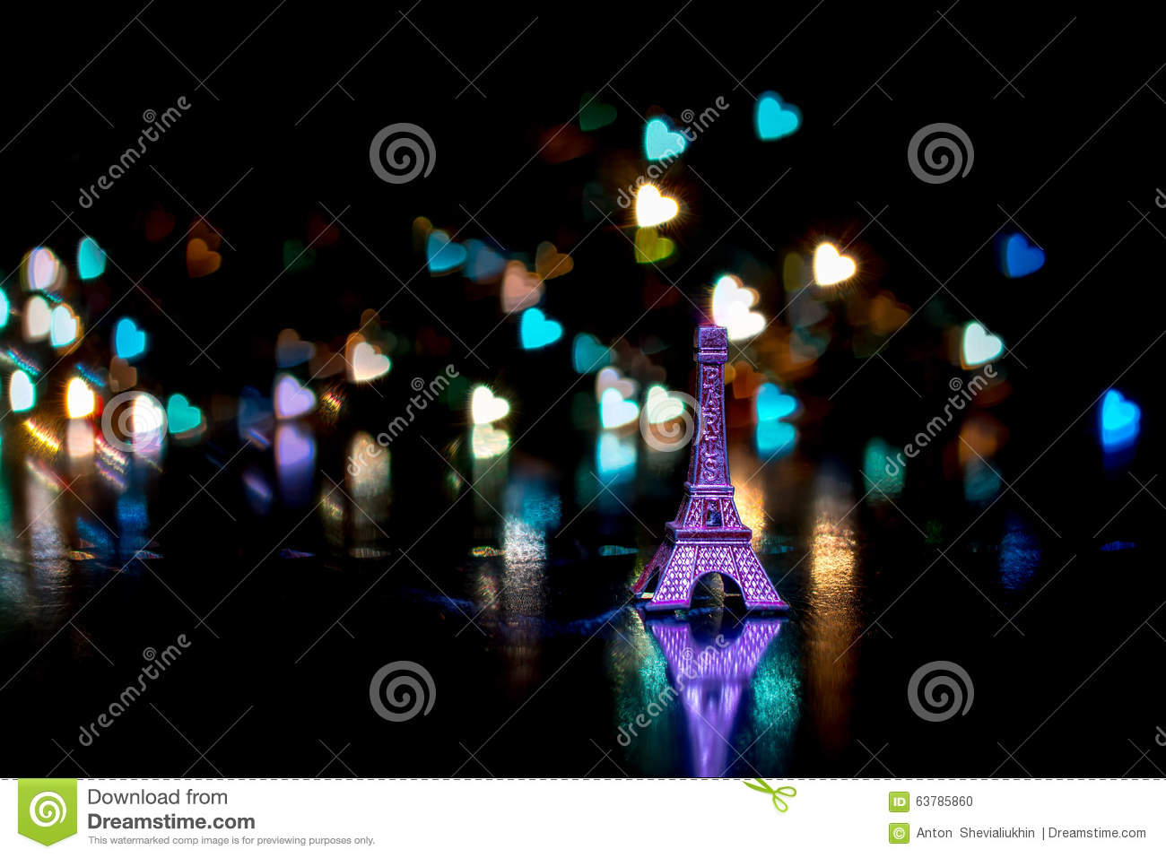 Miniature Eiffel Tower silhouette small keys on the key ring with a reflection on the bokeh in the form of hea