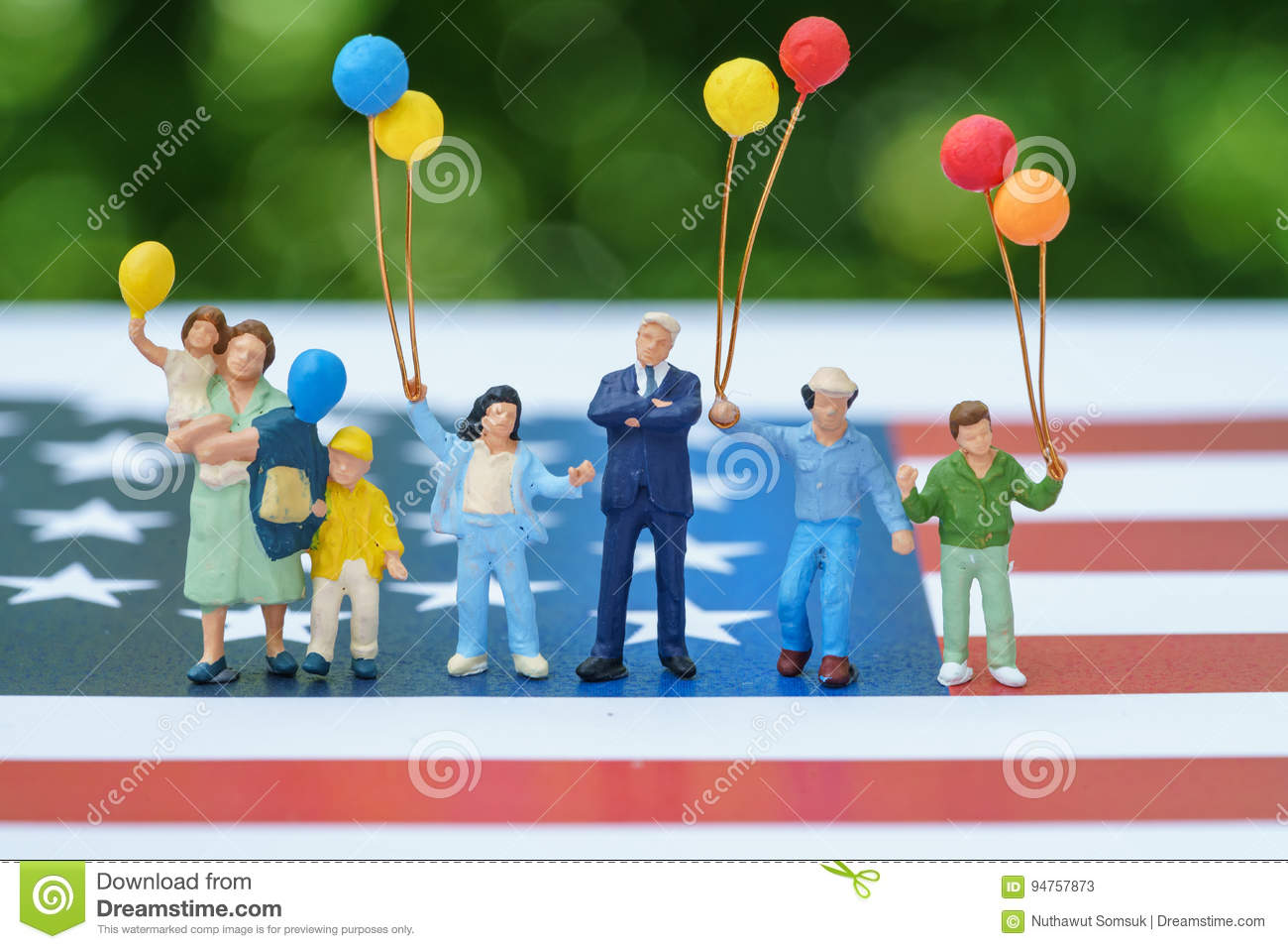 Miniature figure, happy american family holding balloon with Uni