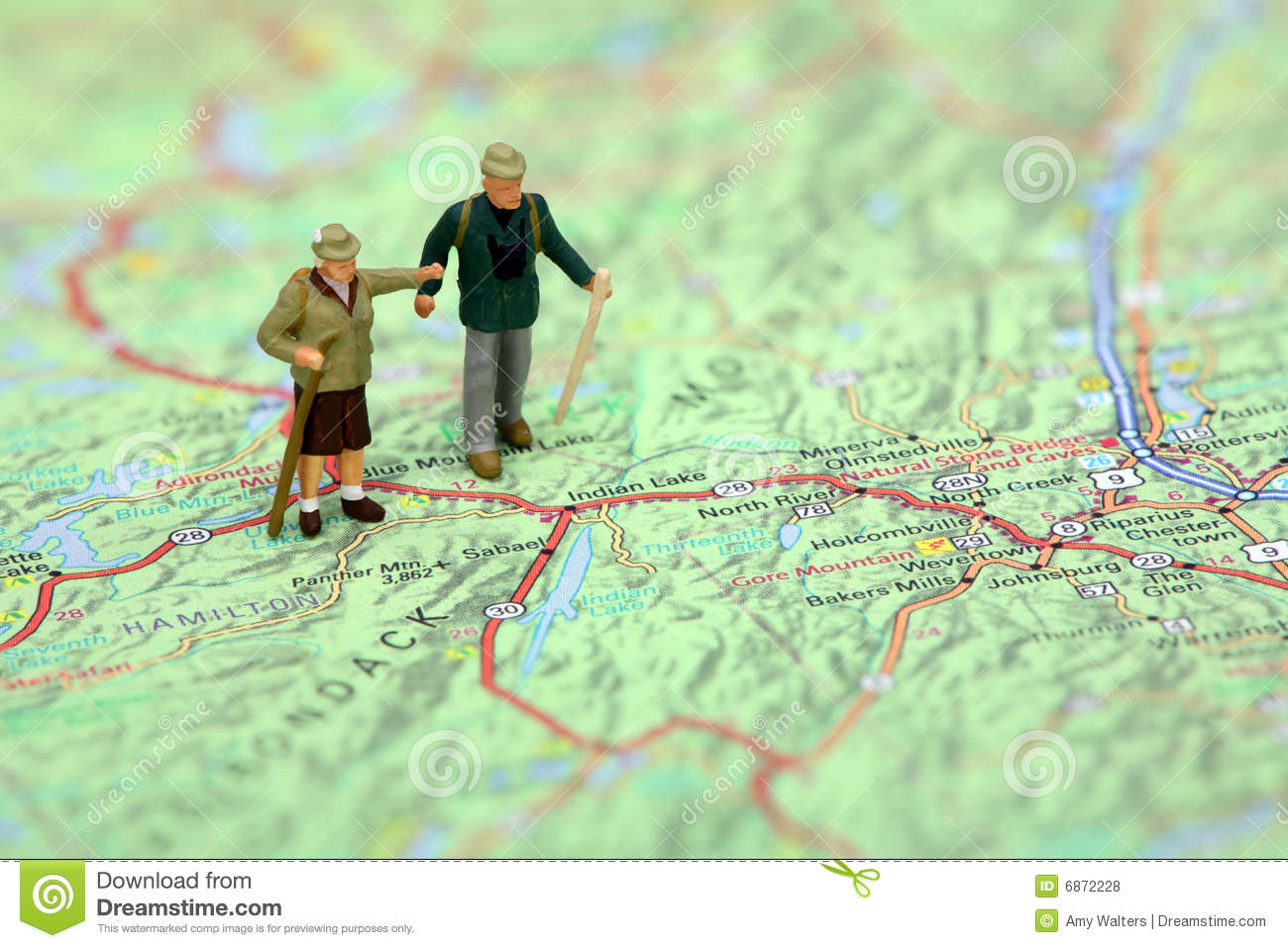 Miniature Hikers Standing On A Map. Royalty Free Stock ...