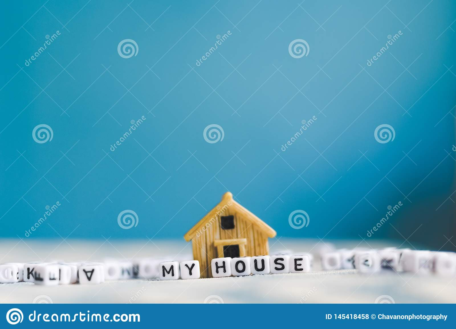 Miniature house model with  HOUSE  alphabet cube letter