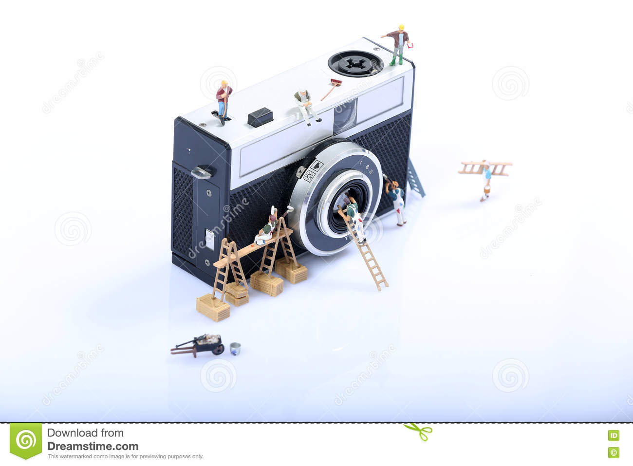 Miniature Men Working Stock Photo Image Of Abstract 71035204 A Camera On Huge