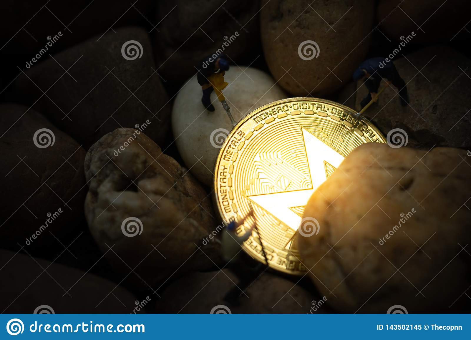 Miniature miners digging golden Monero coin in mine