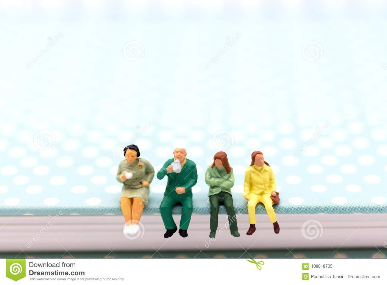 Miniature people : Business team sitting on book and having a coffee break. Image use for business concept