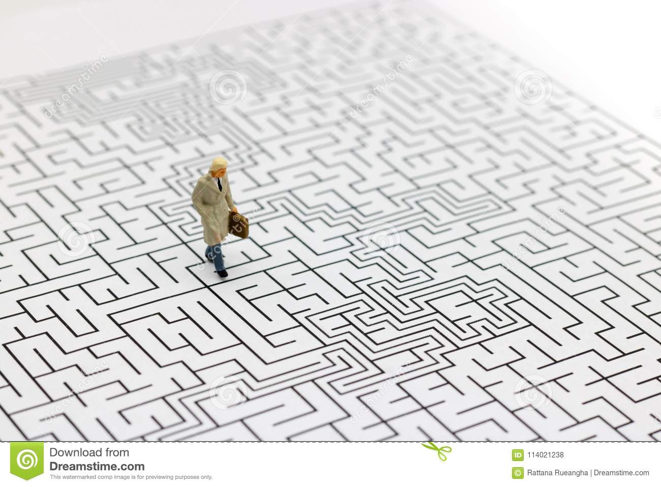 Miniature People: Businessman Standing On Center Of Maze  Concepts
