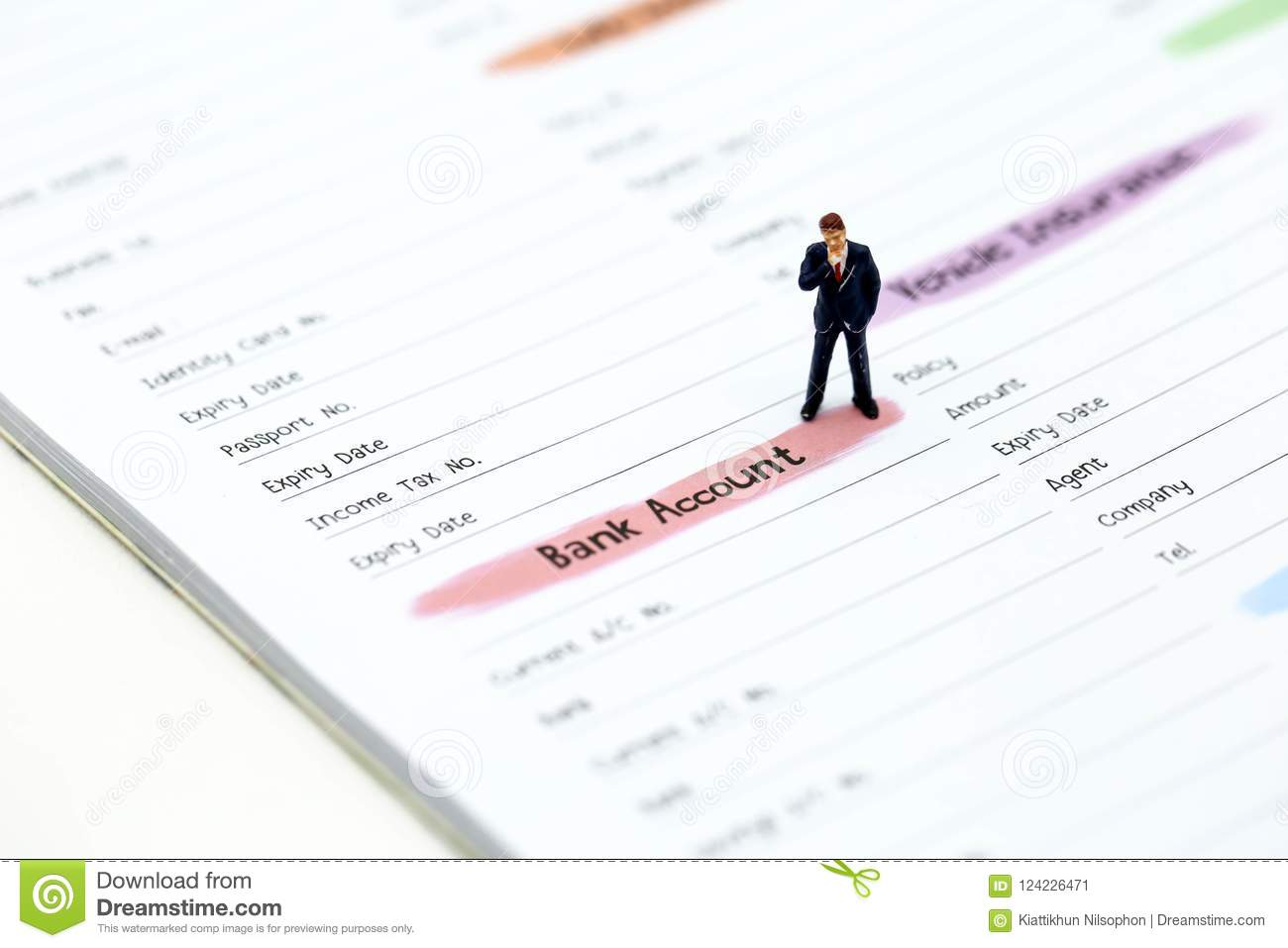 Miniature people businessman standing with list of credit card miniature people businessman standing with list of credit cardconcept for businesstaxmoney reheart Images