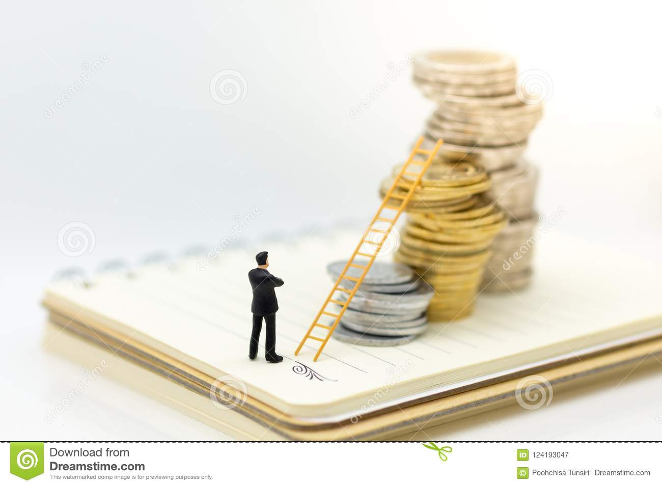 Miniature people: Businessman thinking and standing on stack of coins with stair. Image use for money growth up, business concept