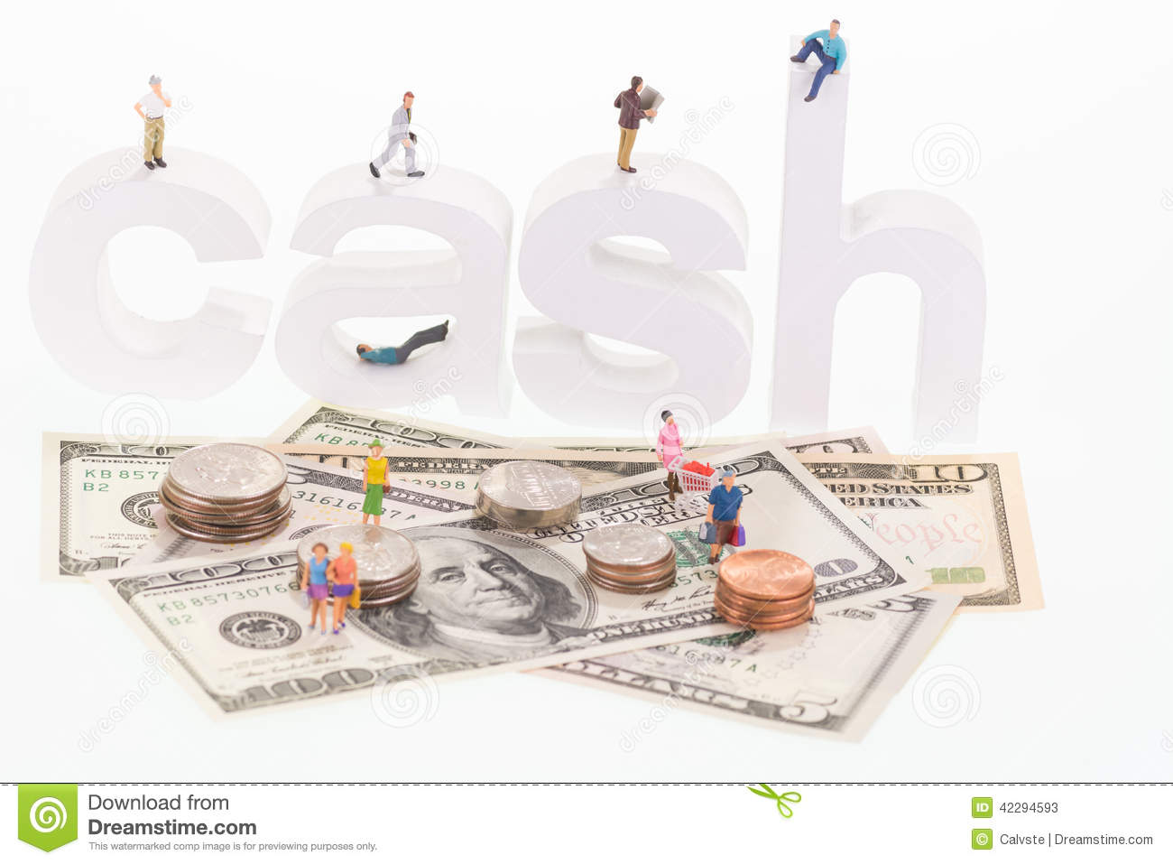 Miniature people on cash wooden letters and US banknotes